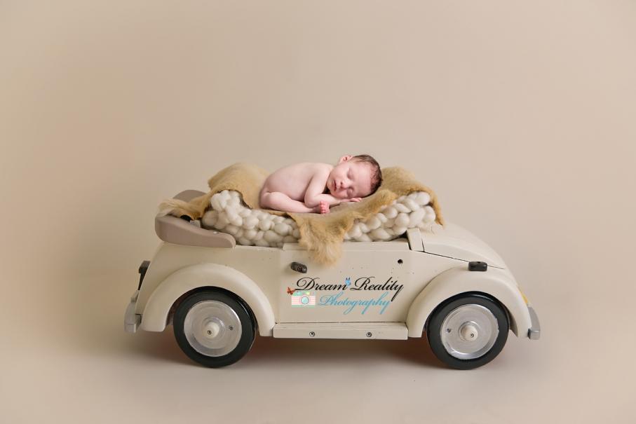 dream_reality_photography_newborn boy in car FB